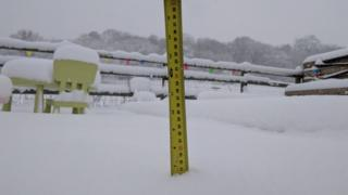 A tap measure in the snow
