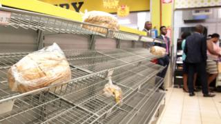 Empty bread shelves in a supermarket in Harare, Zimbabwe, 09 October 2018.