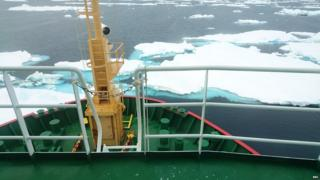 Bow of the ship pushing through shattered ice pack.