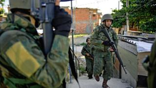 Brazilian military patrol in Jacarezinho favela in Rio de Janeiro on January 18, 2018.