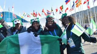 Nigeria's women's bobsleigh and skeleton team members Seun Adigun, Ngozi Onwumere, Akuoma Omeoga and Simidele Adeagbo attend a welcoming ceremony for the team in the Olympic Village in Pyeongchang