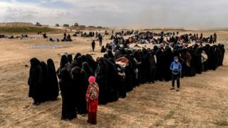 Civilians evacuated from the Islamic State (IS) group's embattled holdout of Baghuz wait at a screening area held by the US-backed Kurdish-led Syrian Democratic Forces (SDF), in the eastern Syrian province of Deir Ezzor, on March 5, 2019
