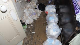 Rubbish and sanitary towels in an upstairs bedroom