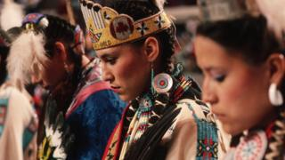 An American Indian dance group prepares to perform in a Native American meeting in Oklahoma City