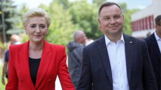 Andrzej Duda with his wife Agata Kornhauser-Duda as they cast their ballots at a polling station