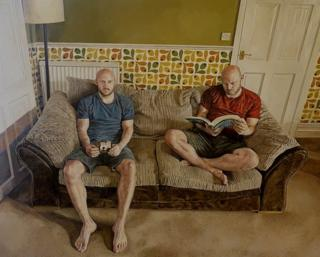 Twin brothers, Michael and David, sitting together on the couch