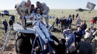 Ground crew help Anton Shkaplerov of Russia to get out of the Soyuz space capsule shortly after landing in Kazakhstan. 3 June 2018