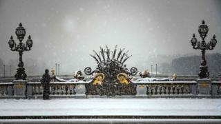The Alexandre III bridge is pictured as snow falls over Paris on 22 January 2019