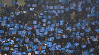 Fans of FC Internazionale cheer their team during the Serie A match between FC Internazionale and SSC Napoli at Stadio Giuseppe Meazza on December 26
