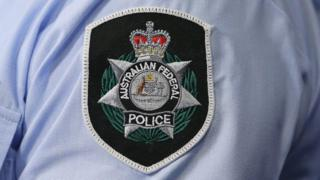 A close up of the Australian Federal Police badge