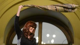 President Cristina Fernandez de Kirchner waves a scarf after a ceremony at the Casa Rosada Presidential Palace in Buenos Aires on 20 August, 2015