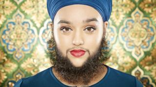 Young woman with full beard