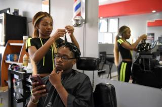 Francina Townes, 18, works as a part-time hairdresser while studying at high school