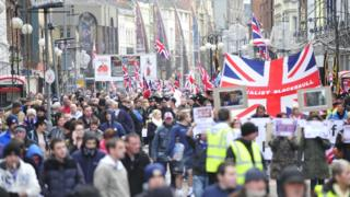 Thousands of people marching through Belfast city centre