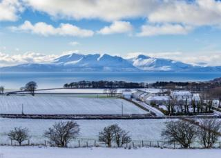 Looking over West Kilbride, North Ayrshire towards the Isle of Arran in the snow