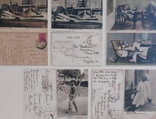 A collection of postcards from the exhibition depicting Indian men relaxing, drinking, reading a newspaper