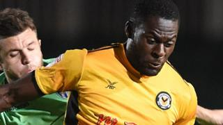 Frank Nouble of Newport County is tackled by Doug Loft of Colchester United