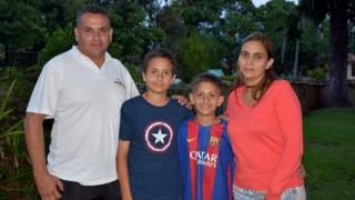 The Páez Yepez family pose for a photo in Merida