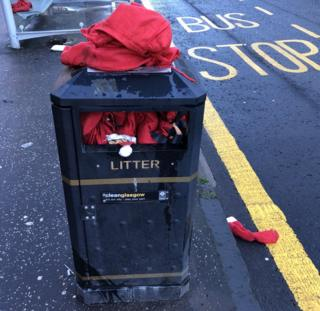 Discarded Santa suits