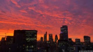 Red sunrise by London skyline