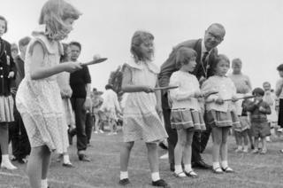 Four girls prepare for egg and spoon race