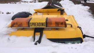 A gritter is buried in snow in Sully, Vale of Glamorgan