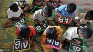 Children learning English in India