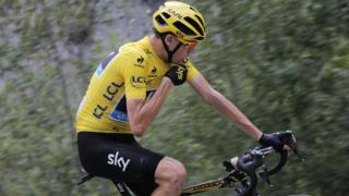 "Britain""s Chris Froome talks to his race director"