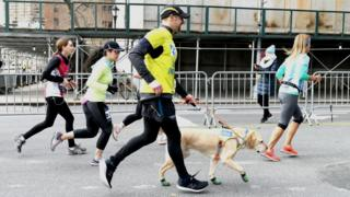 Thomas Panek running the New York City Half Marathon with his guide dog Gus