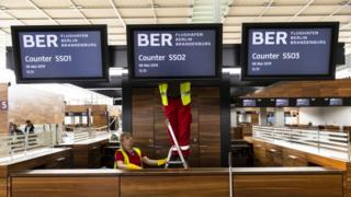 Workers are seen at the construction site of the BER Willy Brandt Berlin Brandenburg International Airport in Schoenefeld, Germany on May 8, 2019