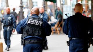 Police officers patrol in Paris