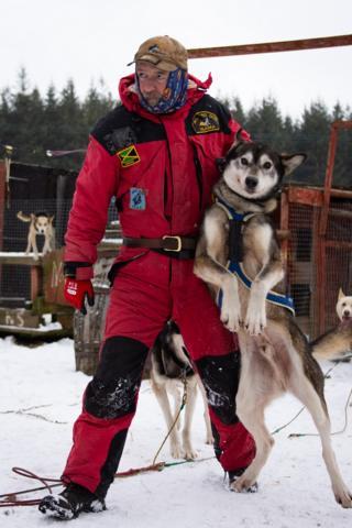 Alan Stewart holds an Alaskan husky at the Cairngorm Sleddog Centre