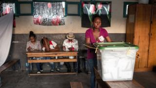 Polling official wait for voters at a polling station of Isotry district in Antananarivo.