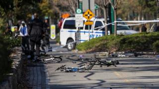 Several bikes are seen crushed along a bike path in Lower Manhattan.