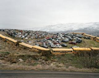 Cars and buses in a junkyard