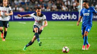 Tottenham Hotspur's English midfielder Dele Alli (C) kicks the ball during the friendly football match between Tottenham Hotspurs and Kitchee FC