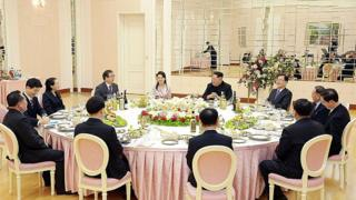 In this handout image from the South Korean Presidential Blue House, Chung Eui-Yong, head of the presidential National Security Office talks with North Korean leader Kim Jong-Un (5th R) during a dinner in Pyongyang, North Korea on March 5, 2018.