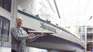 Lego artist Steve Mayes with his Turbinia model, standing next to the real Turbinia
