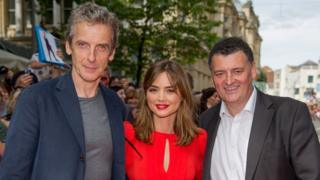 Steven Moffat (right) Peter Capaldi (left) and Jenna Coleman (centre)
