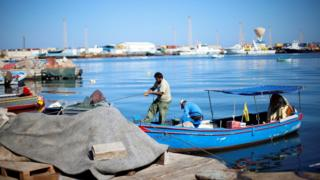 Libyan fishermen moor their boat at Tripoli harbour, Libya November 3, 2017.