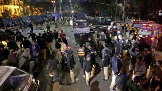 Security officials inspect the scene of a suicide bomb attack that targeted a protest by pharmacists outside the Punjab provincial assembly in Lahore, Pakistan, 13 February 2017