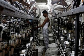 An employee works inside a garment factory in Mumbai, India February 28, 2017
