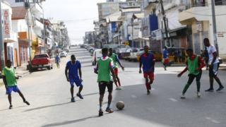 People playing football in the streets of Monrovia