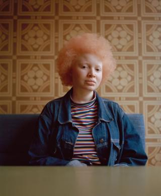 Portrait of a woman sat down
