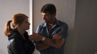 "Fugitive Jason Stange discussing a scene with co-star Katie Hemming during filming for the movie ""Marla Mae"""