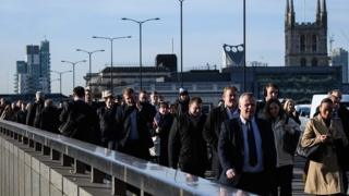 Commuters crossing London Bridge