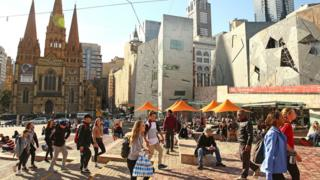 Federation Square, a popular meeting place, sits across the road from St Paul's Cathedral