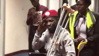 Bobi Wine in a wheelchair prior to his departure at Entebbe International Airport, Uganda, 31 August 2018