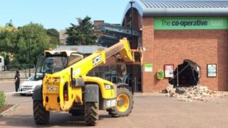 Hole left by thieves in Co-op