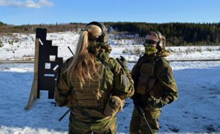 Two soldiers talk during training